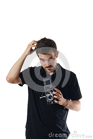 Handsome man with vintage kcamera scratching head