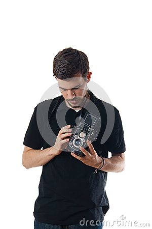 Handsome man with vintage photo camera
