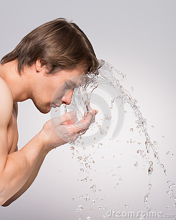 Free Handsome Man Washing His Clean Face. Royalty Free Stock Photography - 44484977