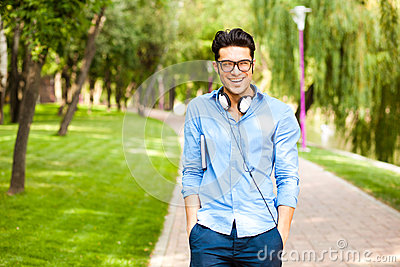 Handsome man wlaking in the park on a sunny day