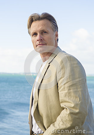 Handsome mature man in beige blazer