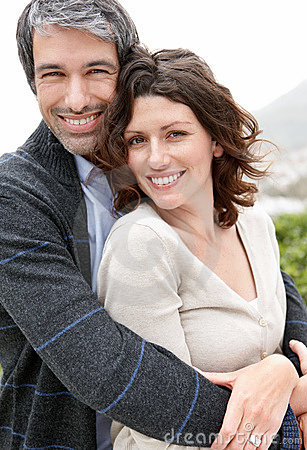 Handsome mature man hugging his wife from behind
