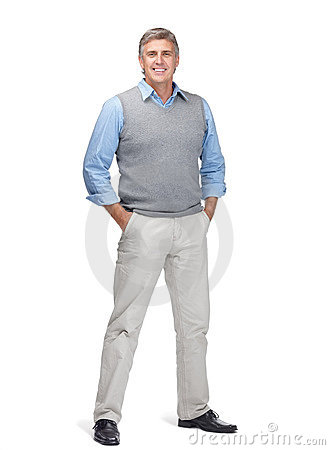 Handsome mature man standing with hands in pocket