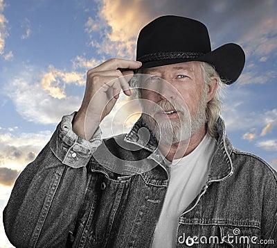 Handsome mature man wearing a black hat