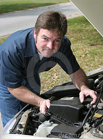 Free Handsome Mechanic Under Hood Royalty Free Stock Photography - 632257