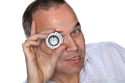 Handsome middle aged man holding lens to eye