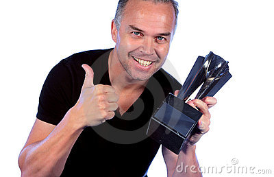Handsome middle aged man with winners trophy