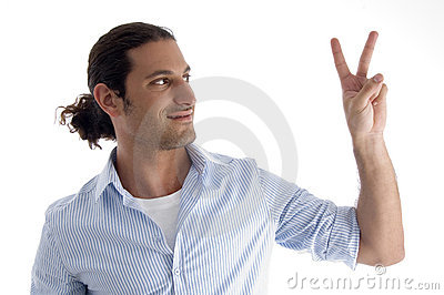Handsome model gesturing victory
