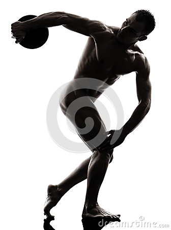 Handsome naked muscular man exercising discobolus  silhouette