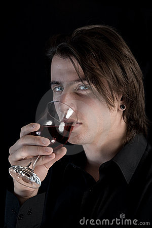 Handsome pale vampire drinking blood