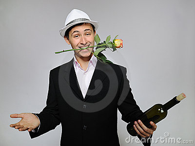 Handsome romantic man with rose flower,vine bottle