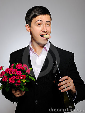 Handsome romantic young man with rose flower