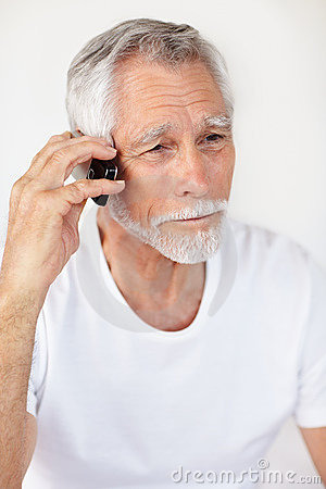 A handsome senior man communicating on a mobile