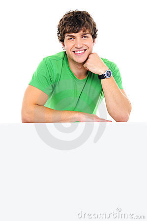 Handsome smiling man lean on the white billboard