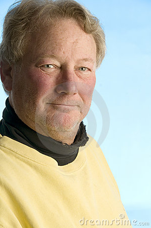 Handsome smiling middle age man worn portrait