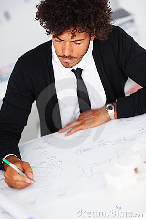 Handsome successful business man busy working