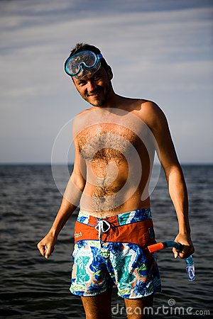 handsome summer diving man with swimming mask