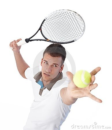 Handsome tennis player serving