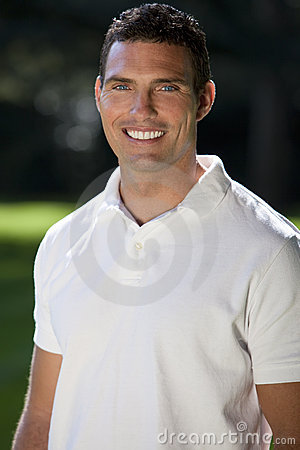 Handsome Thirties Man In White Polo Shirt