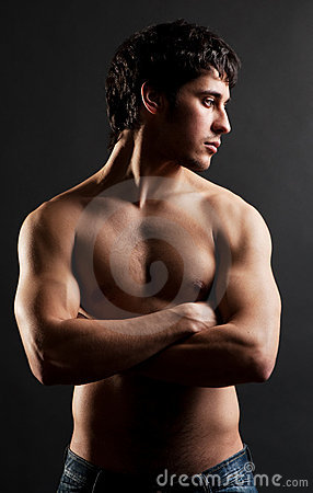 Handsome thoughtful man with naked torso