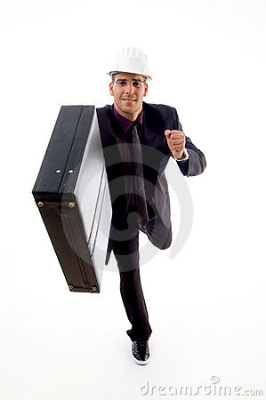 Handsome young architect in running gesture