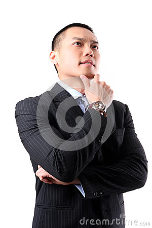 Handsome young asian business man thinking
