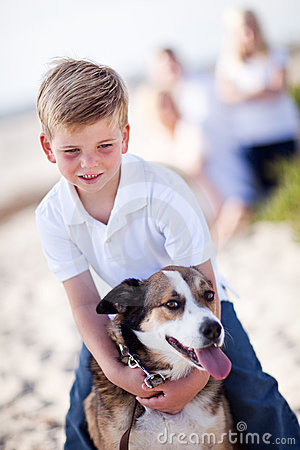 Handsome Young Boy Playing With His Dog Stock Photo - Image: 16930090
