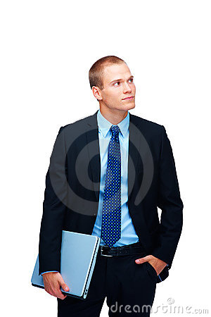 Handsome young business man holding a laptop