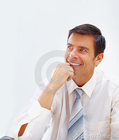 Handsome young business man lost in thoughts