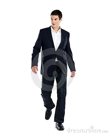 Handsome young business man walking on white