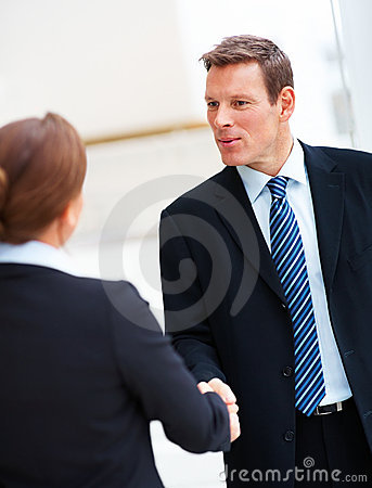 Handsome young business men shaking hands