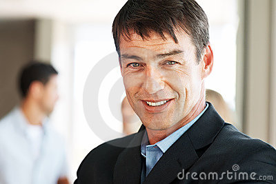 Handsome young businessman looking happy