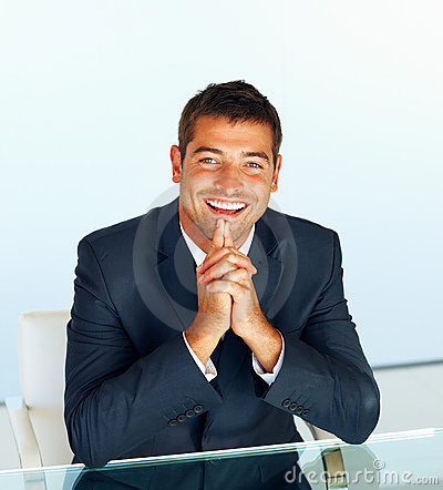 Handsome young businessman sitting on chair