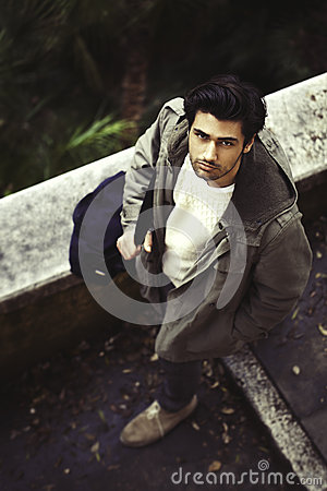 Free Handsome Young Italian Man Walking In The Street Royalty Free Stock Photos - 68517048