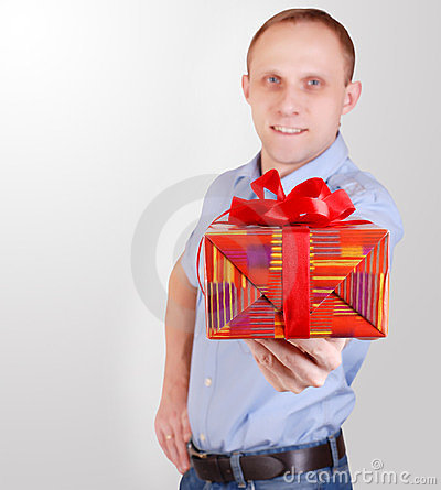 Handsome young man with gift box