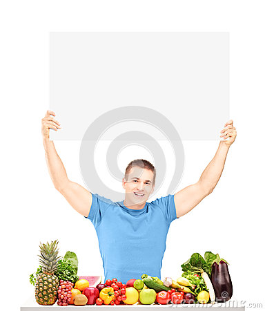 Free Handsome Young Man Holding A Blank Panel And Posing With Food Royalty Free Stock Image - 29564046