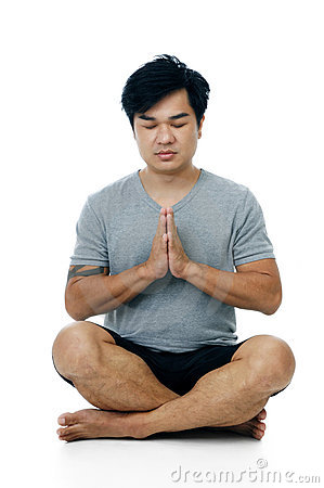Handsome young man in meditation pose