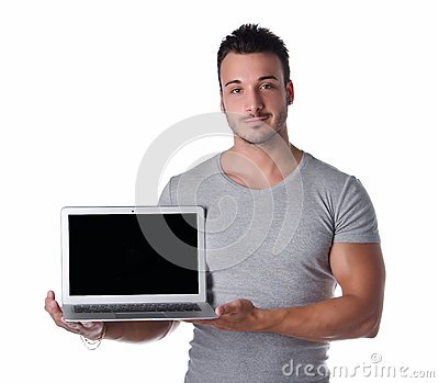 Handsome young man showing laptop computer