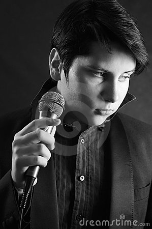 Handsome young man singer with microphone Elvis