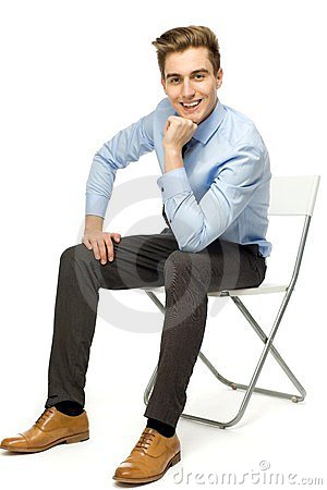 Handsome young man sitting