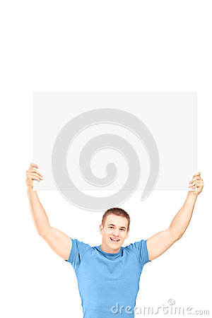 Free Handsome Young Man Sitting And Holding A White Panel Stock Images - 29396834