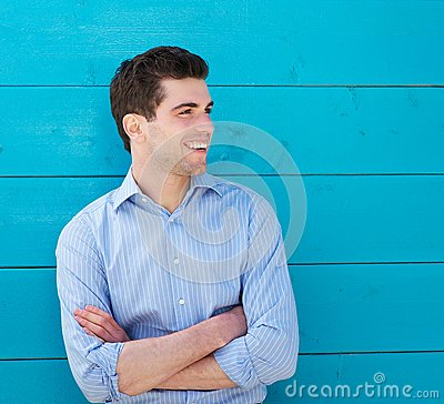Handsome young man smiling outdoors