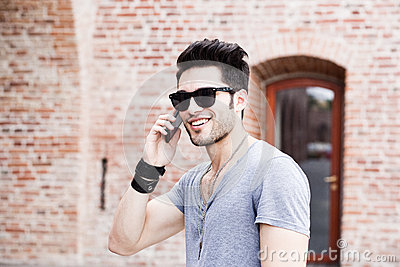 Handsome young man talking on a smartphone