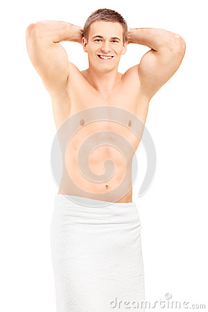 Handsome young man in towel posing