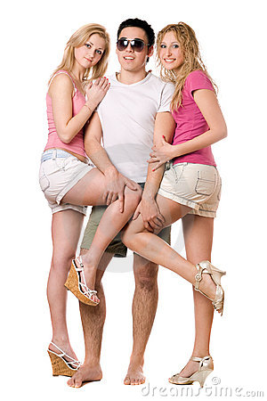 Handsome young man and two playful girls
