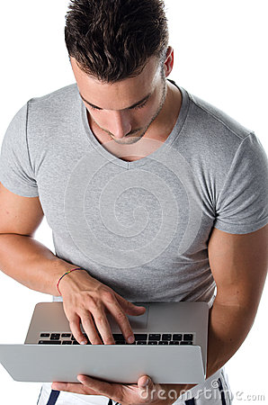 Handsome young man using laptop computer