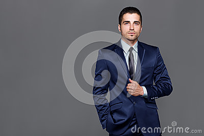 Handsome young man wears a watch Stock Photo