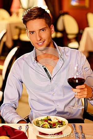 Free Handsome Young Man With Glass Of Red Wine Royalty Free Stock Image - 36754046