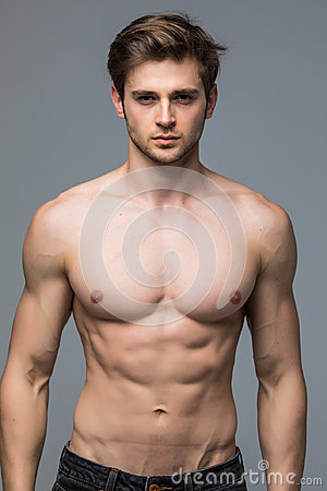 Free Handsome Young Man With Nude Torso Looking At Camera Over Gray B Stock Photos - 96586173
