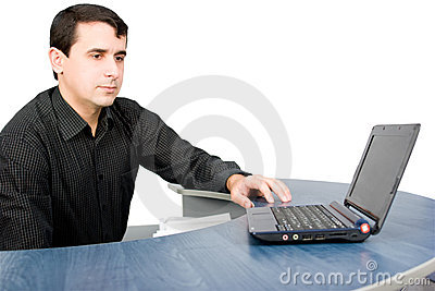 Handsome young manager working with laptop